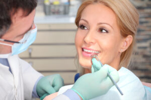 blond lady in dental chair